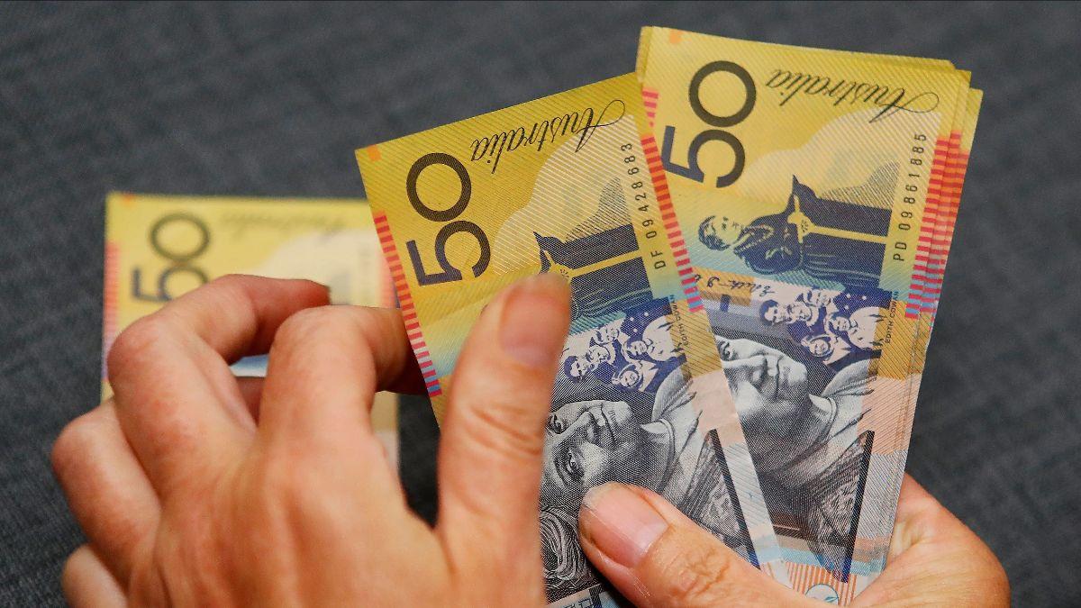 Australian Dollars in hands